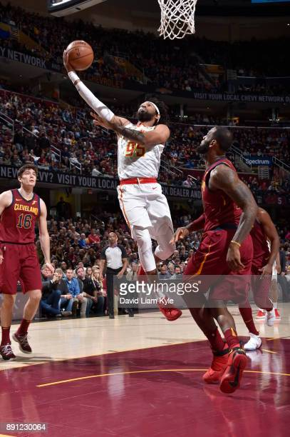 DeAndre' Bembry of the Atlanta Hawks shoots a lay up against the Cleveland Cavaliers on December 12 2017 at Quicken Loans Arena in Cleveland Ohio...