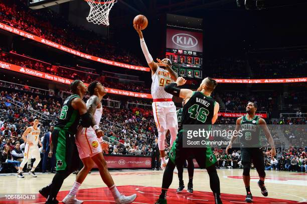 DeAndre' Bembry of the Atlanta Hawks shoots the ball against the Boston Celtics on November 23 2018 at State Farm Arena in Atlanta Georgia NOTE TO...