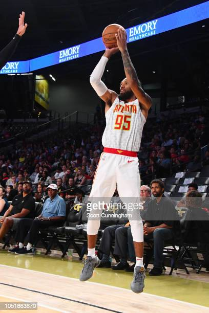 DeAndre' Bembry of the Atlanta Hawks shoots the ball against the San Antonio Spurs during a preseason game on October 10 2018 at McCamish Pavilion in...