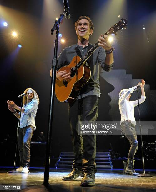 DeAndre Brackensick Phillip Phillips and Colton Dixon perform during the American Idol Live tour at the Bridgestone Arena on August 12 2012 in...