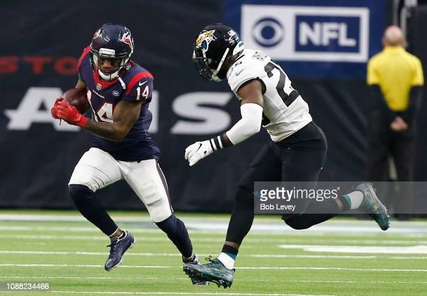 DeAndre Carter of the Houston Texans runs with the ball as D.J. Hayden of the Jacksonville Jaguars pursues during the fourth quarter at NRG Stadium...