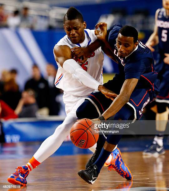 DeAndre Daniels of the Connecticut Huskies and Will Yeguete of the Florida Gators battle for a loose ball during the NCAA Men's Final Four Semifinal...