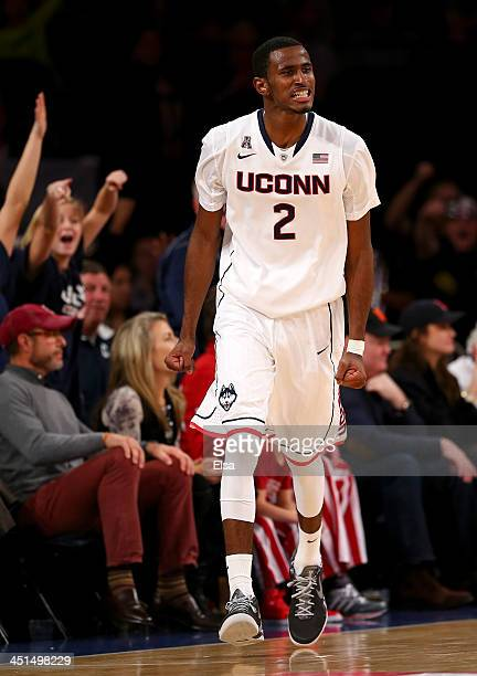 DeAndre Daniels of the Connecticut Huskies celebrates his three point shot in the final minutes of the game against the Indiana Hoosiers during the...