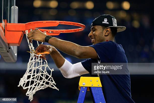 DeAndre Daniels of the Connecticut Huskies cuts the net after defeating the Kentucky Wildcats 6054 in the NCAA Men's Final Four Championship at ATT...