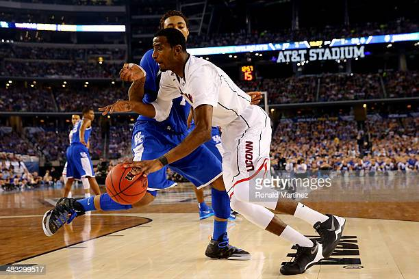 DeAndre Daniels of the Connecticut Huskies drives to the basket as James Young of the Kentucky Wildcats defends during the NCAA Men's Final Four...
