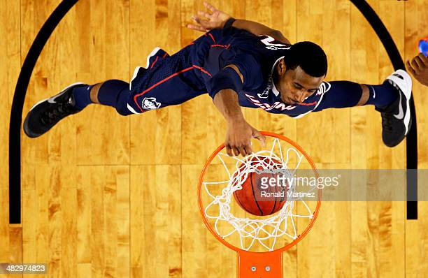 DeAndre Daniels of the Connecticut Huskies dunks against the Florida Gators during the NCAA Men's Final Four Semifinal at ATT Stadium on April 5 2014...