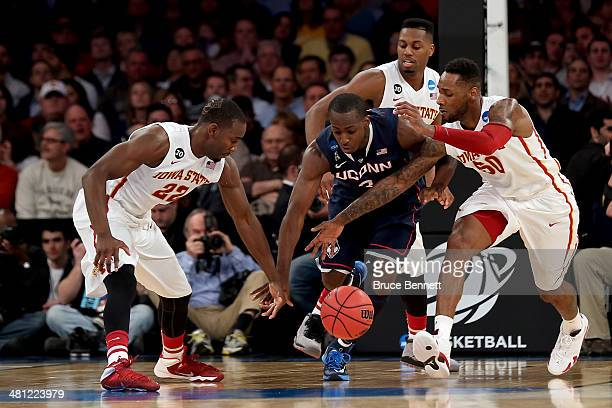 DeAndre Daniels of the Connecticut Huskies fights for the ball against Dustin Hogue and DeAndre Kane of the Iowa State Cyclones during the regional...