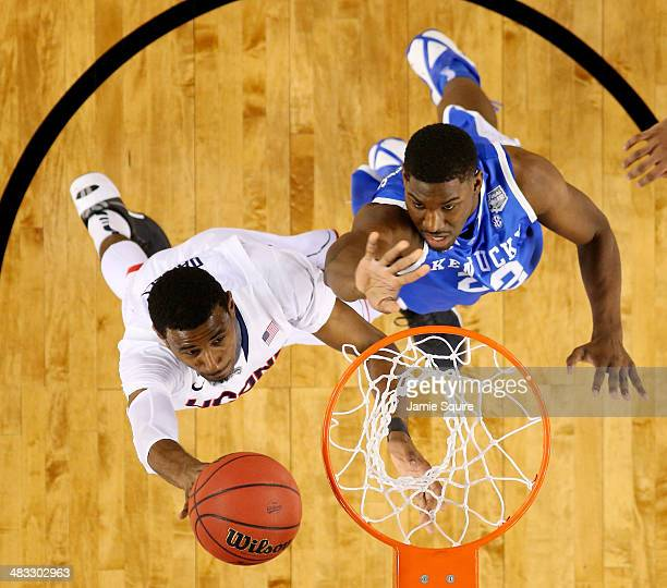 DeAndre Daniels of the Connecticut Huskies goes to the basket against Alex Poythress of the Kentucky Wildcats during the NCAA Men's Final Four...