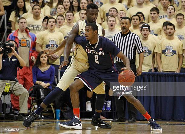 DeAndre Daniels of the Connecticut Huskies handles the ball against the Pittsburgh Panthers at Petersen Events Center on January 19, 2013 in...