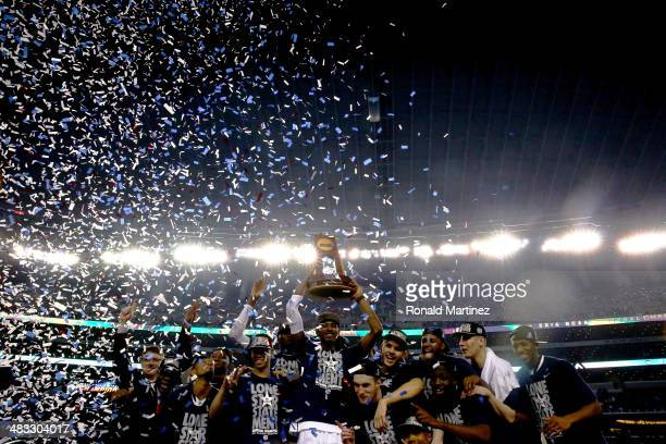 DeAndre Daniels of the Connecticut Huskies holds up the trophy after defeating the Kentucky Wildcats 6054 in the NCAA Men's Final Four Championship...