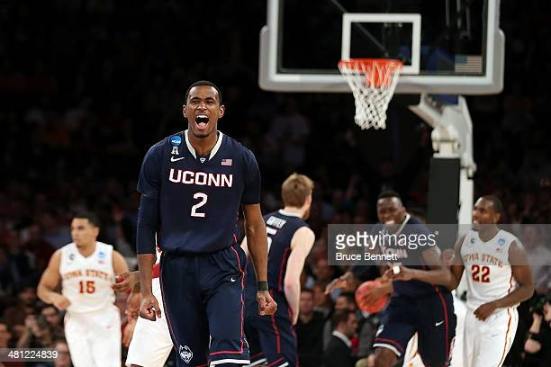 DeAndre Daniels of the Connecticut Huskies reacts after a basket against the Iowa State Cyclones during the regional semifinal of the 2014 NCAA Men's...