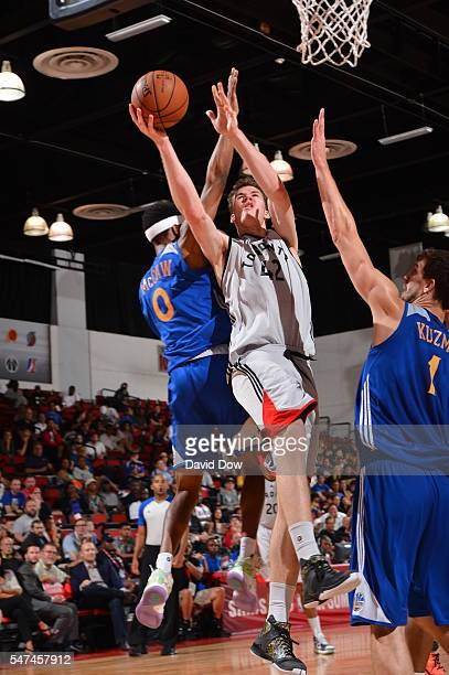 DeAndre Daniels of the Toronto Raptors goes to the basket against the Golden State Warriors during the 2016 NBA Las Vegas Summer League game on July...