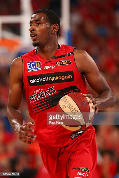 DeAndre Daniels of the Wildcats brings the ball up the court during the NBL round eight game between the Perth Wildcats and the Cairns Taipans at...