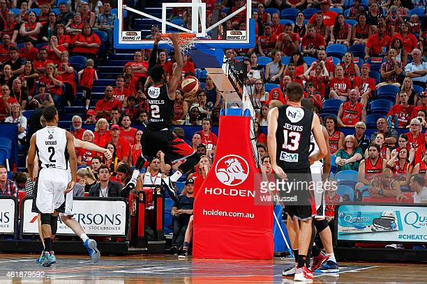 DeAndre Daniels of the Wildcats hangs from the basket during the round 15 NBL match between the Perth Wildcats and Melbourne United at Perth Arena on...