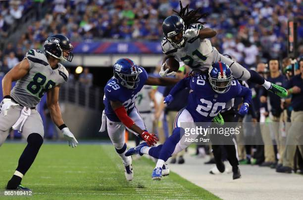 DeAndre Elliott of the Seattle Seahawks is knocked outofbounds by Janoris Jenkins of the New York Giants during the second quarter of the game at...