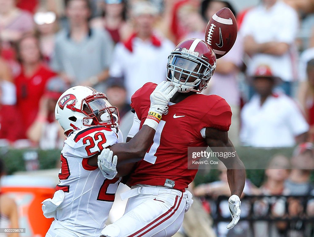 DeAndre Farris #22 of the Western Kentucky Hilltoppers is flagged for pass interference as he breaks up a pass intended for Robert Foster #1 of the Alabama Crimson Tide at Bryant-Denny Stadium on September 10, 2016 in Tuscaloosa, Alabama.