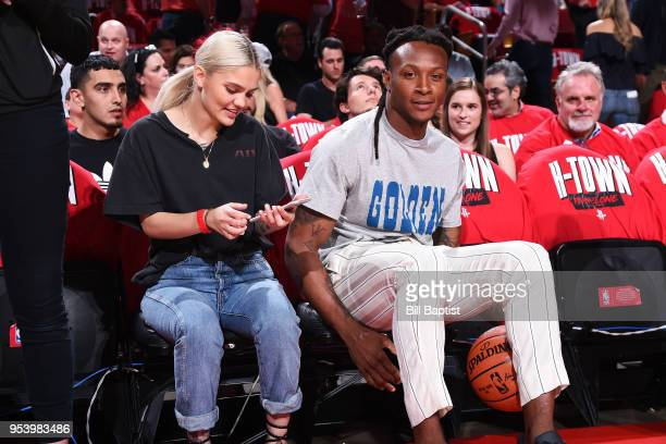 Deandre Hopkins and Amina Blue attend a game between the Houston Rockets and Utah Jazz in Game Two of Round Two of the 2018 NBA Playoffs on May 2...