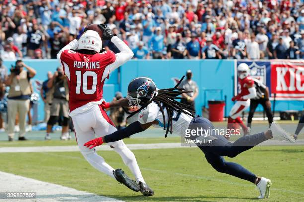 DeAndre Hopkins of the Arizona Cardinals catches a 5-yard touchdown pass from \ari1#2 during the first quarter at Nissan Stadium on September 12,...