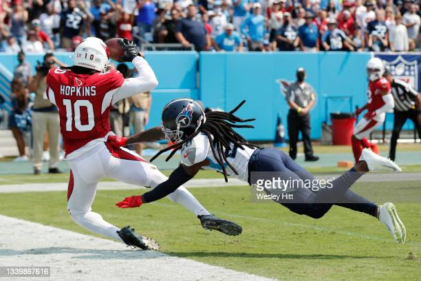 DeAndre Hopkins of the Arizona Cardinals catches a 5-yard touchdown pass against the Tennessee Titans during the first quarter at Nissan Stadium on...