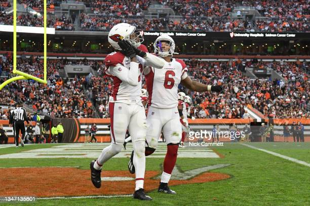 DeAndre Hopkins of the Arizona Cardinals celebrates a touchdown with teammate James Conner during the third quarter against the Cleveland Browns at...