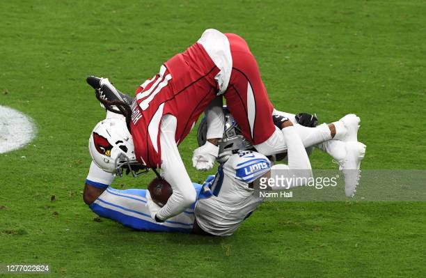 DeAndre Hopkins of the Arizona Cardinals is tackled by Jeff Okudah of the Detroit Lions during the first quarter at State Farm Stadium on September...