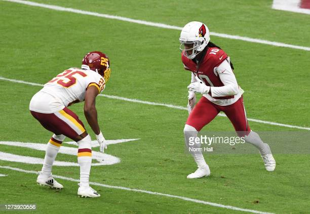 DeAndre Hopkins of the Arizona Cardinals runs up field while being defended by Fabian Moreau of the Washington Football Team at State Farm Stadium on...