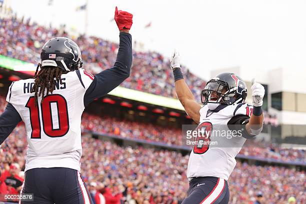 DeAndre Hopkins of the Houston Texans and Cecil Shorts of the Houston Texans celebrate a touchdown against the Buffalo Bills during the second half...