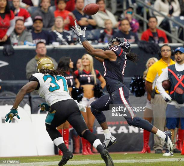 DeAndre Hopkins of the Houston Texans attempts to catch the ball as Johnathan Cyprien of the Jacksonville Jaguars defends in the fourth quarter at...