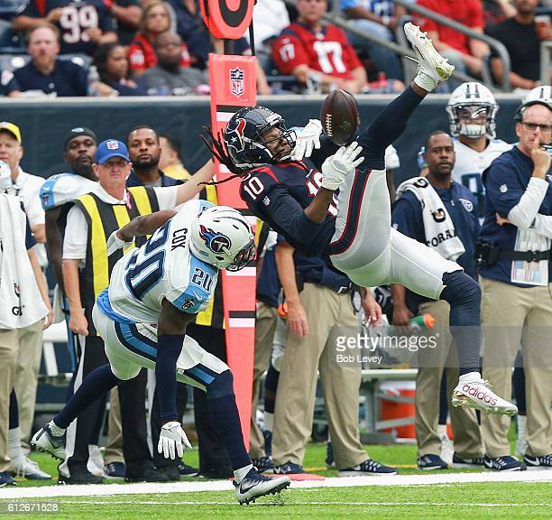 DeAndre Hopkins of the Houston Texans can't hold on to the pass as Perrish Cox of the Tennessee Titans defends at NRG Stadium on October 2 2016 in...