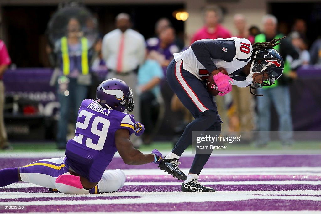 DeAndre Hopkins #10 of the Houston Texans catches a 1 yard touchdown pass over Xavier Rhodes #29 of the Minnesota Vikings during the fourth quarter of the game on October 9, 2016 at US Bank Stadium in Minneapolis, Minnesota. The Vikings defeated the Texans 31-13.
