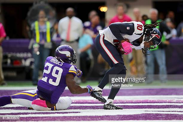 DeAndre Hopkins of the Houston Texans catches a 1 yard touchdown pass over Xavier Rhodes of the Minnesota Vikings during the fourth quarter of the...