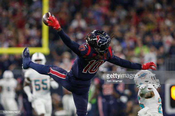 DeAndre Hopkins of the Houston Texans catches a pass defended by Xavien Howard of the Miami Dolphins in the third quarter at NRG Stadium on October...