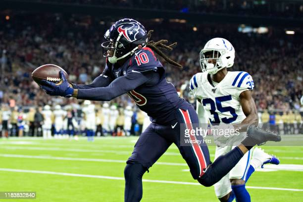 DeAndre Hopkins of the Houston Texans catches a pass for a touchdown during the second half of a game against the Indianapolis Colts at NRG Stadium...