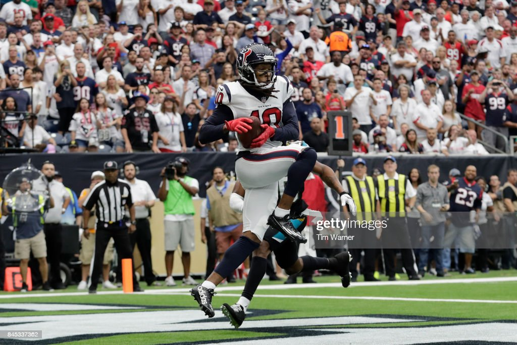 DeAndre Hopkins #10 of the Houston Texans catches a pass for a touchdown defended by Jalen Ramsey #20 of the Jacksonville Jaguars during the third quarter at NRG Stadium on September 10, 2017 in Houston, Texas.