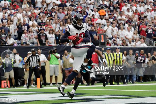 DeAndre Hopkins of the Houston Texans catches a pass for a touchdown defended by Jalen Ramsey of the Jacksonville Jaguars during the third quarter at...