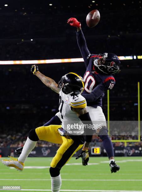 DeAndre Hopkins of the Houston Texans catches a pass for a touchdown in the fourth quarter defended by Joe Haden of the Pittsburgh Steelers at NRG...