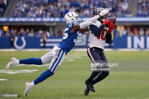 DeAndre Hopkins of the Houston Texans catches a pass while being tackled by Pierre Desir of the Indianapolis Colts during the third quarter at Lucas...