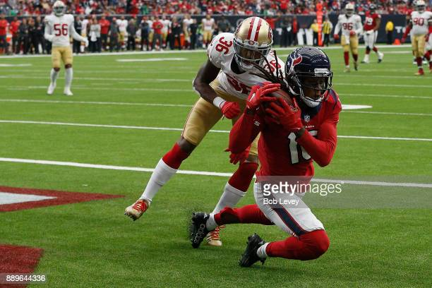 DeAndre Hopkins of the Houston Texans catches a touchdown pass defended by Dontae Johnson of the San Francisco 49ers in the third quarter at NRG...