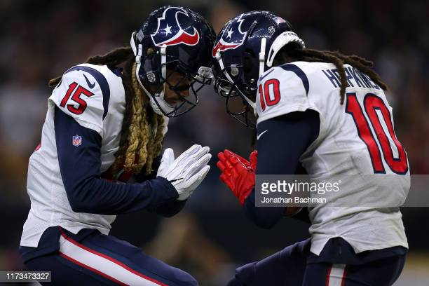 DeAndre Hopkins of the Houston Texans celebrates a touchdown with Will Fuller during the second half of a game against the New Orleans Saints at the...