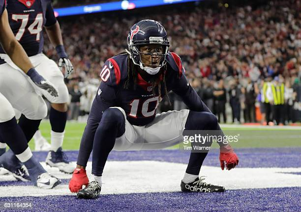 DeAndre Hopkins of the Houston Texans celebrates after catching a touchdown pass during the second quarter of the AFC Wild Card game against the...