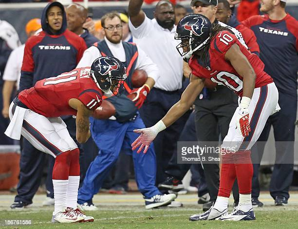 DeAndre Hopkins of the Houston Texans celebrates his catch with DeVier Posey of the Houston Texans against the Indianapolis Colts November 03 2013 at...