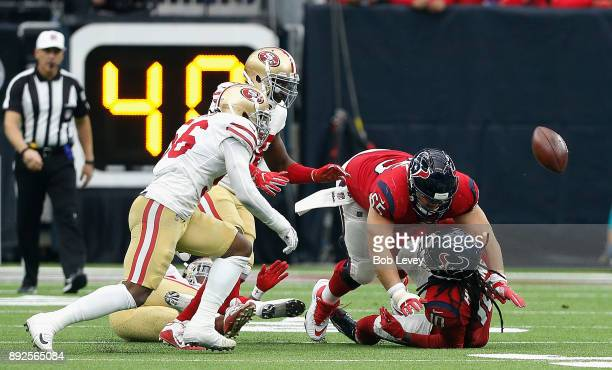 DeAndre Hopkins of the Houston Texans fumbles the ball after taking a hit from Adrian Colbert of the San Francisco 49ers at NRG Stadium on December...