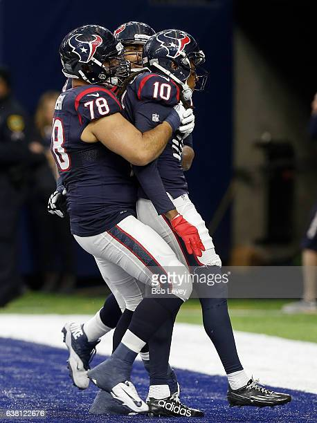DeAndre Hopkins of the Houston Texans is congratulated by Oday Aboushi after scoring against the Oakland Raiders in their AFC Wild Card game at NRG...