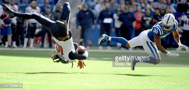 DeAndre Hopkins of the Houston Texans is flipped into the air after being tackled by George Odum of the Indianapolis Colts during the second quarter...