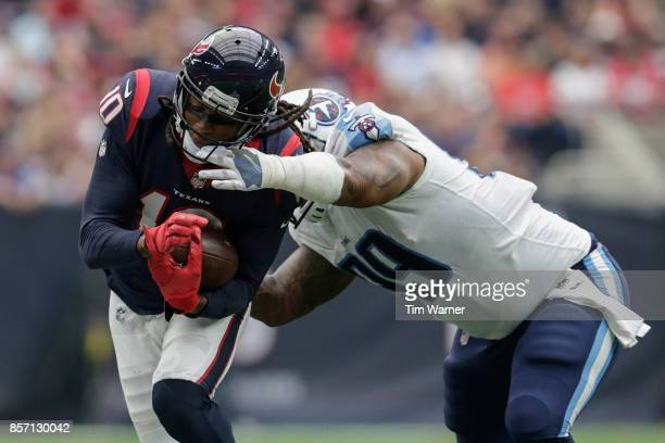 DeAndre Hopkins of the Houston Texans is tackled by Jurrell Casey of the Tennessee Titans in the first half at NRG Stadium on October 1, 2017 in...