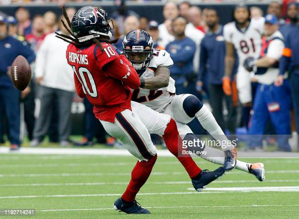 DeAndre Hopkins of the Houston Texans is tackled by Kareem Jackson of the Denver Broncos in the first quarter at NRG Stadium on December 08, 2019 in...
