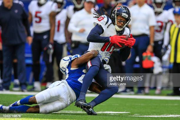 DeAndre Hopkins of the Houston Texans is tackled by Kenny Moore II of the Indianapolis Colts at Lucas Oil Stadium on September 30 2018 in...