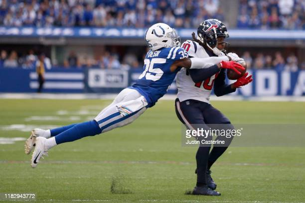 DeAndre Hopkins of the Houston Texans is tackled by Pierre Desir of the Indianapolis Colts at Lucas Oil Stadium on October 20, 2019 in Indianapolis,...