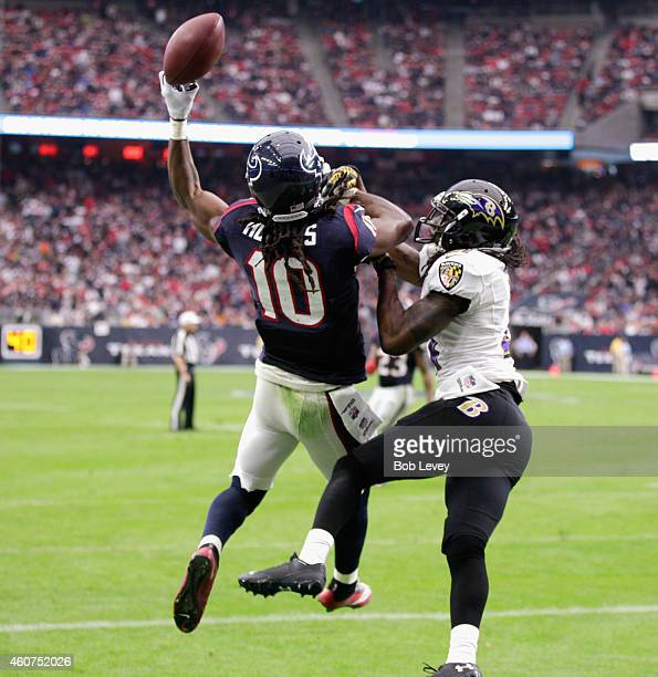 DeAndre Hopkins of the Houston Texans is unable to make the catch in the endzone as he is defended by Lardarius Webb of the Baltimore Ravens at NRG...