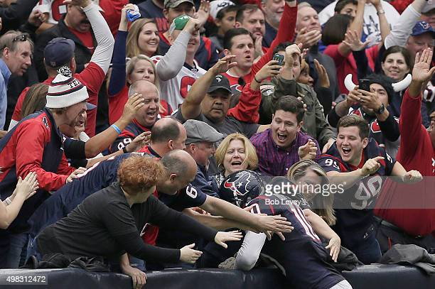 DeAndre Hopkins of the Houston Texans jumps in the stands after making a touchdown against the New York Jets in the second quarter on November 22...
